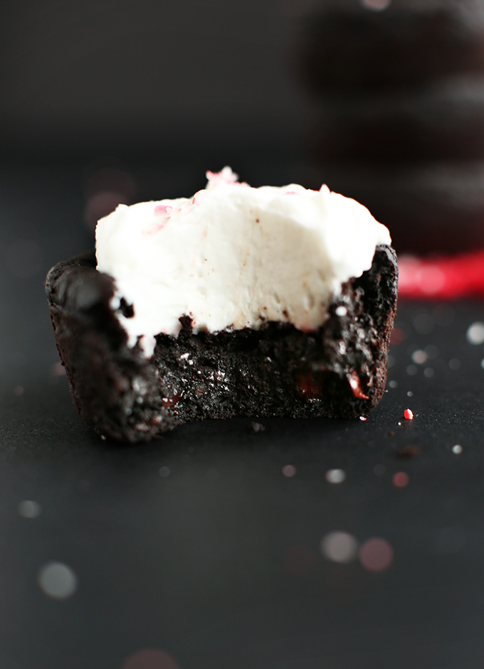 Partially eaten Fudgy Vegan Black Bean Brownie topped with coconut whipped cream