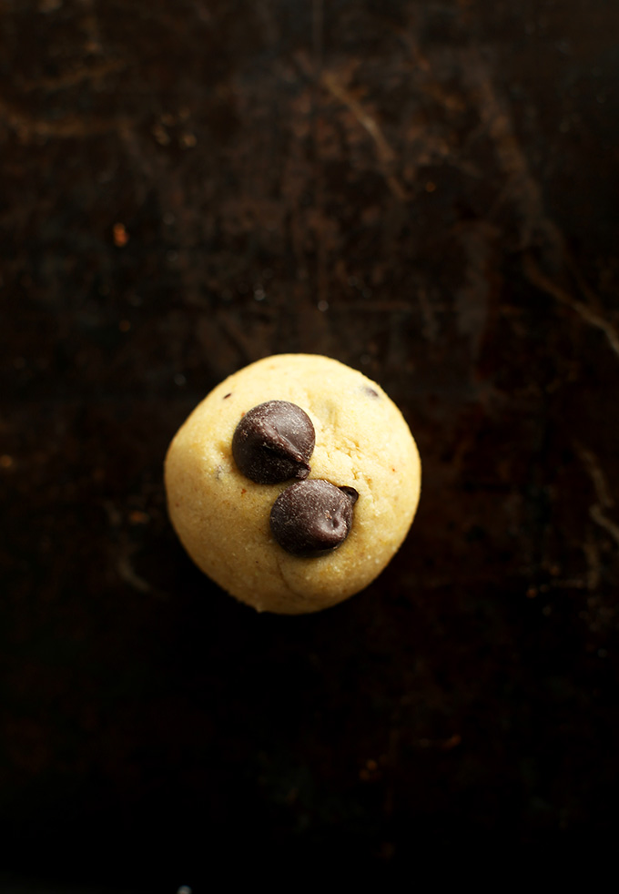 Ball of Gluten-Free Chocolate Chip Cookie dough topped with two chocolate chips