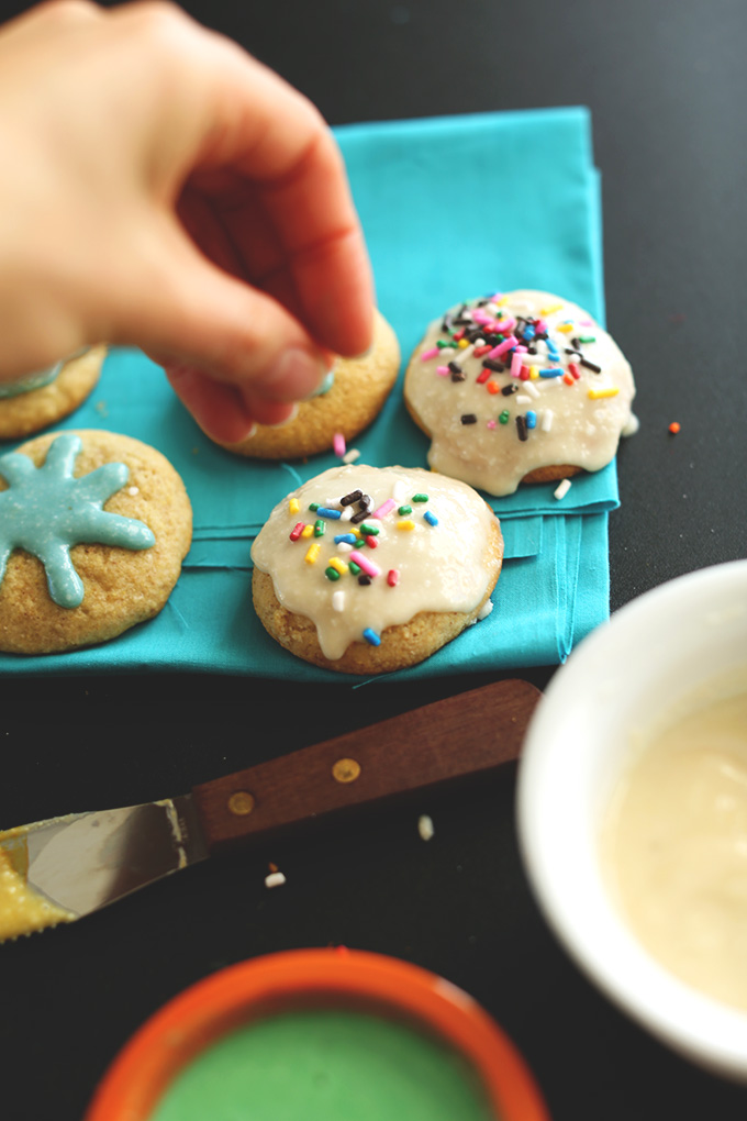 Adding sprinkles on top of our Gluten-Free Sugar Cookies with Vegan Frosting
