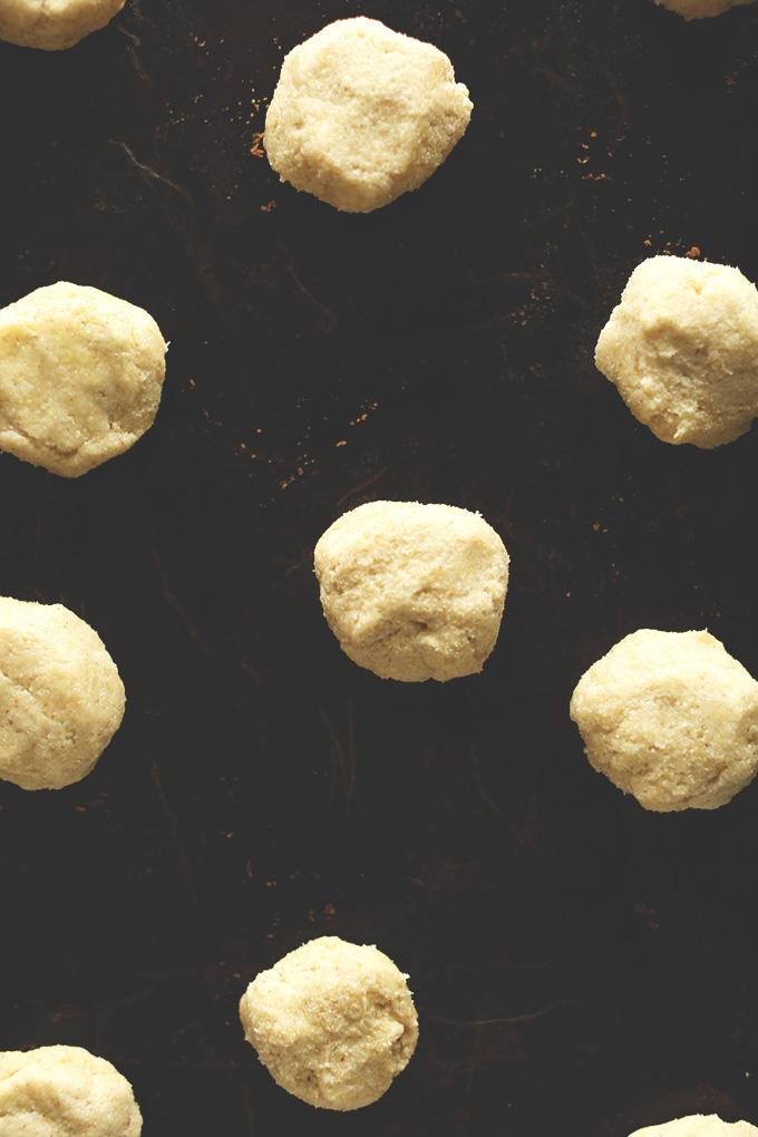 Baking sheet with balls of Gluten-Free Sugar Cookie Dough