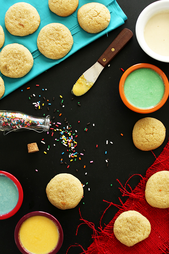 Plain sugar cookies and bowls of healthy homemade frosting for decorating