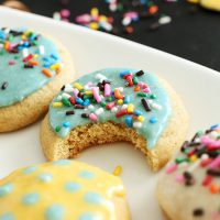Plate of sugar cookies with Coconut Macadamia Frosting