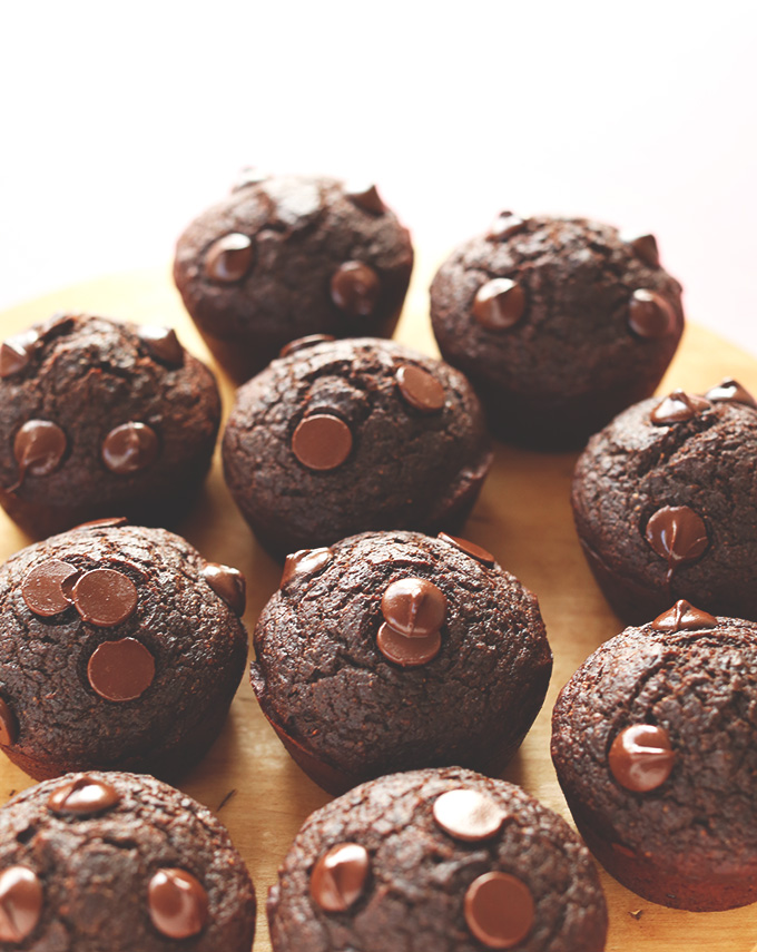 Batch of Healthy Chocolate Muffins resting on parchment paper