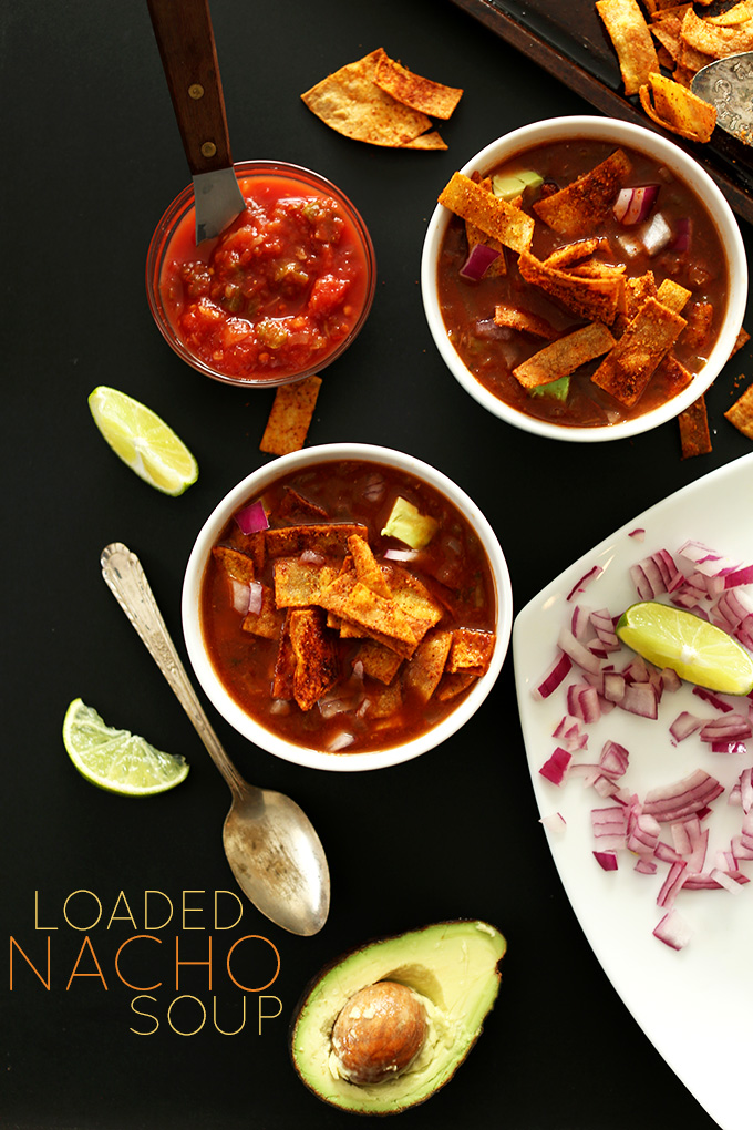 Two bowls of Loaded Nacho Soup with toppings for a delicious vegan meal