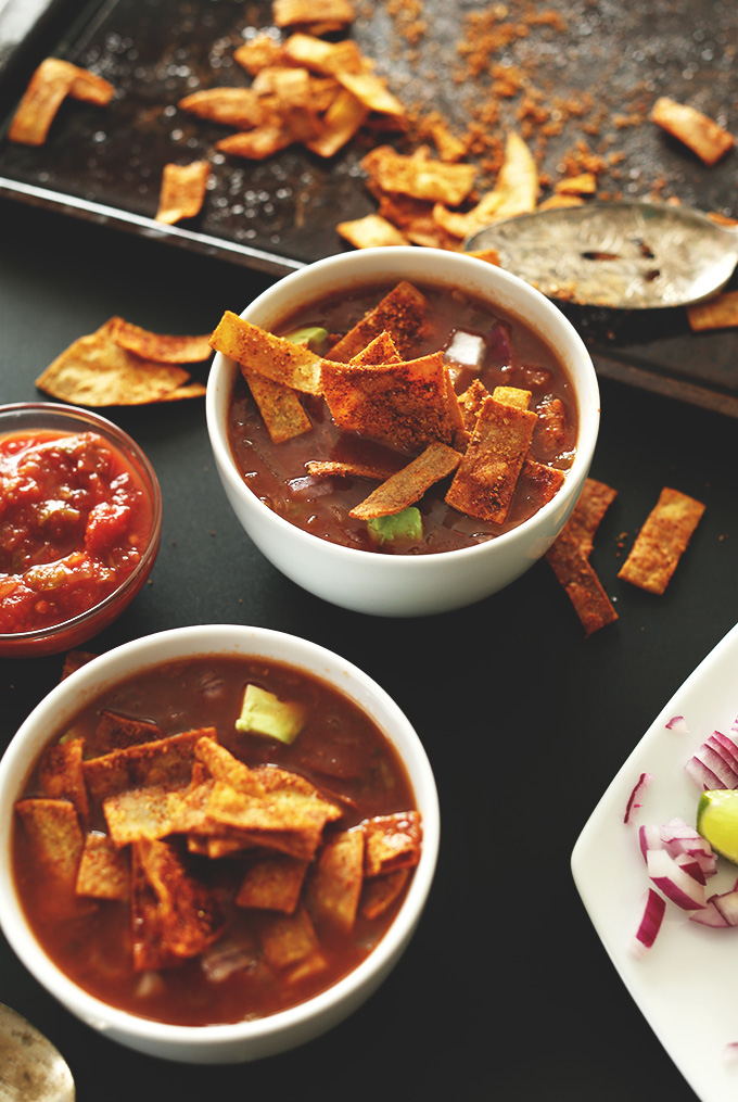 Bowls of Loaded Veggie Nacho Soup topped with DIY Chili Cheese Fritos