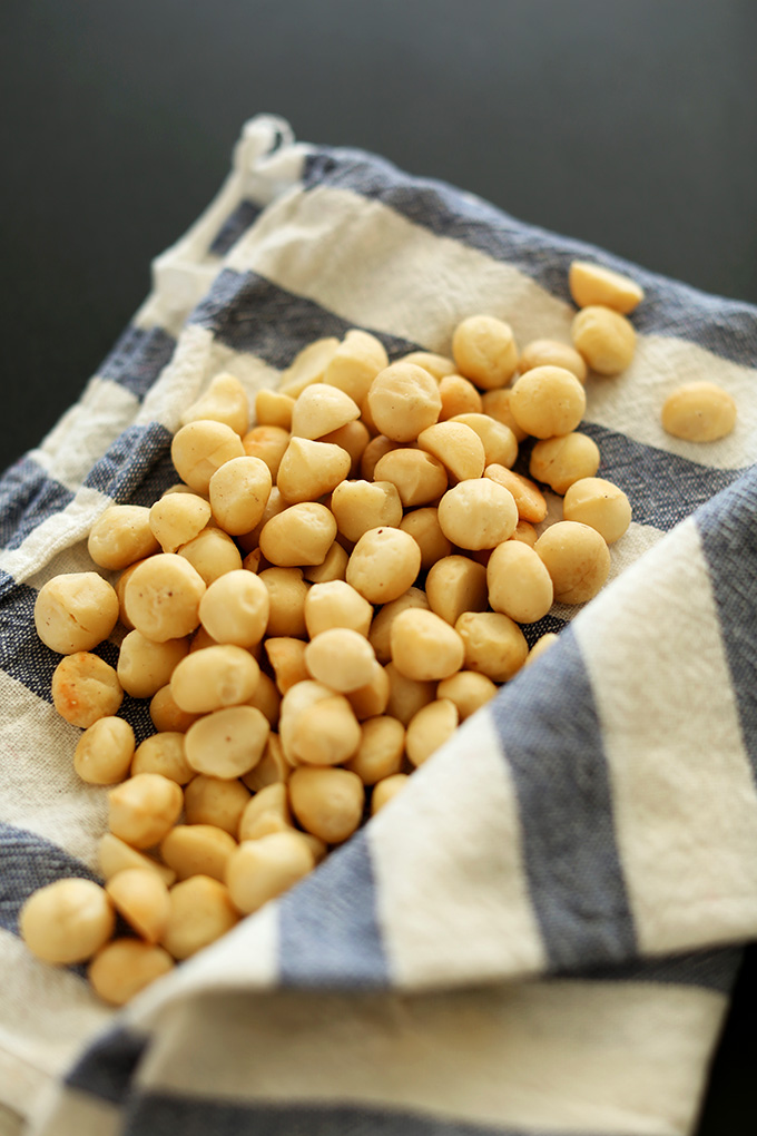 Macadamia nuts resting on a kitchen towel
