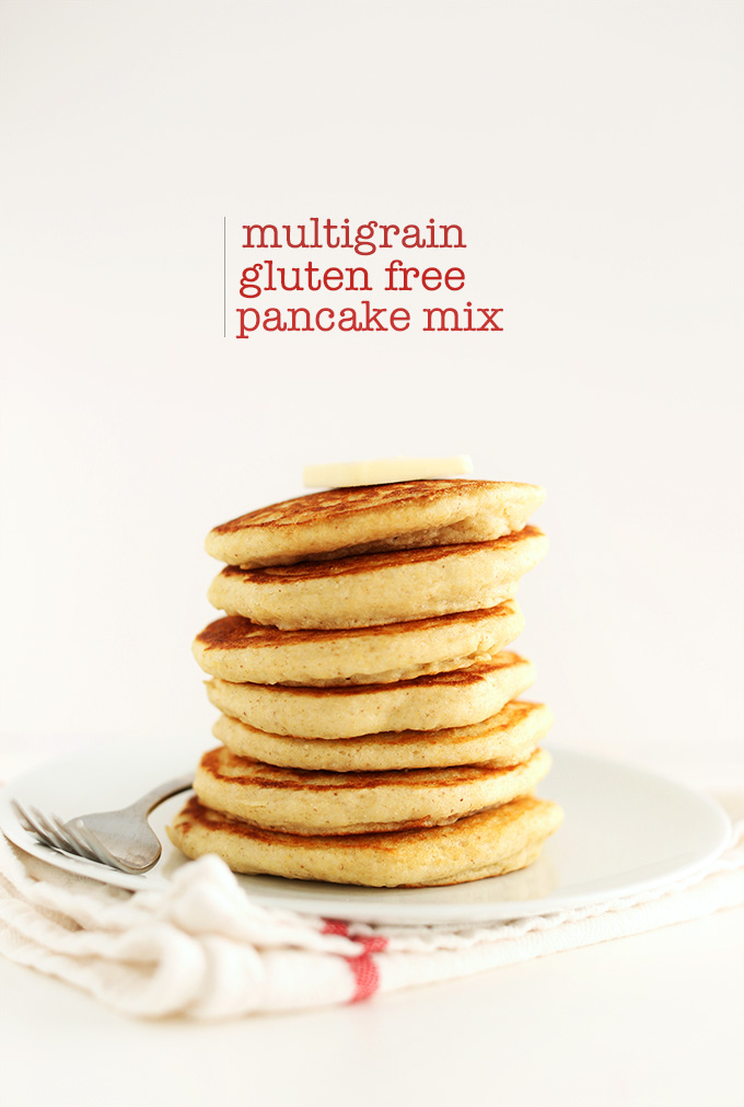 Stack of Multigrain Gluten-Free Pancakes topped with a slab of vegan butter