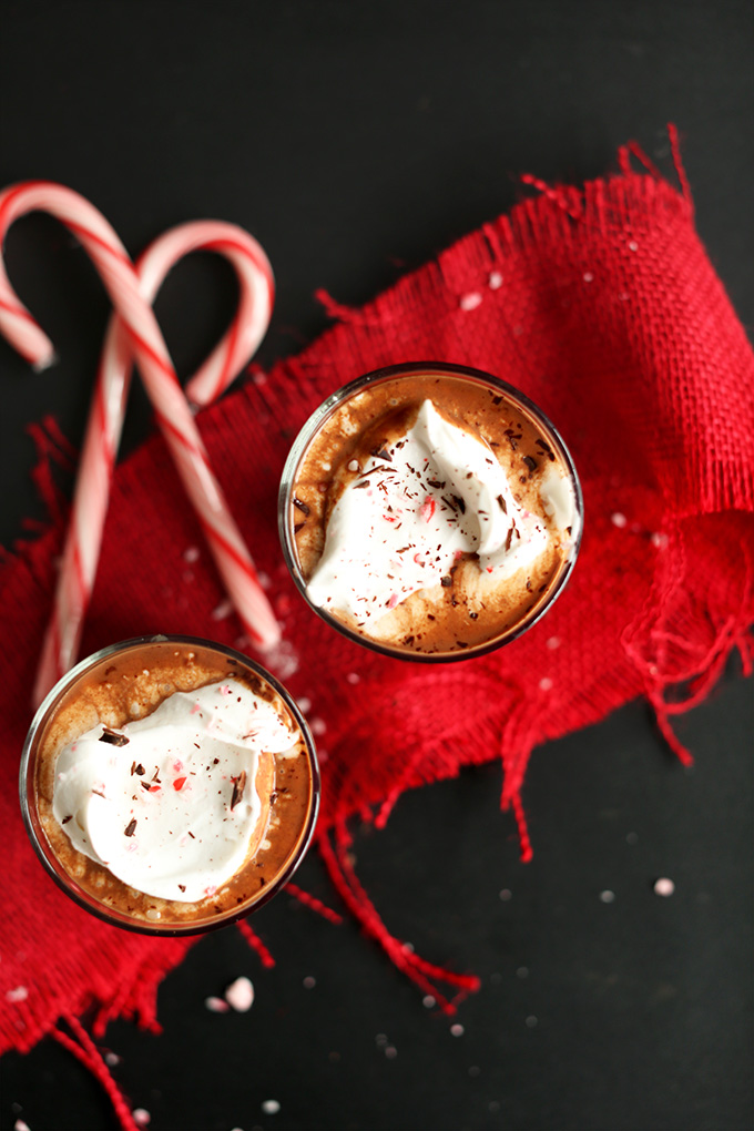 Glasses of Peppermint Vegan Drinking Chocolate topped with coconut whipped cream