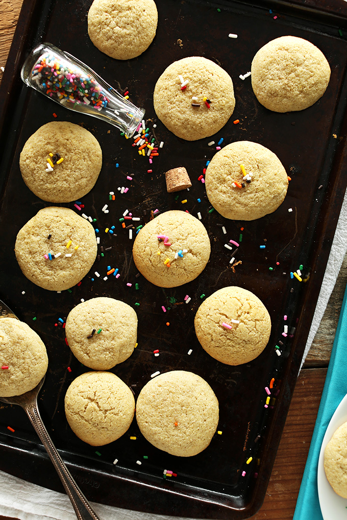Baking sheet with rainbow sprinkles and a batch of our Gluten-free Sugar Cookies recipe
