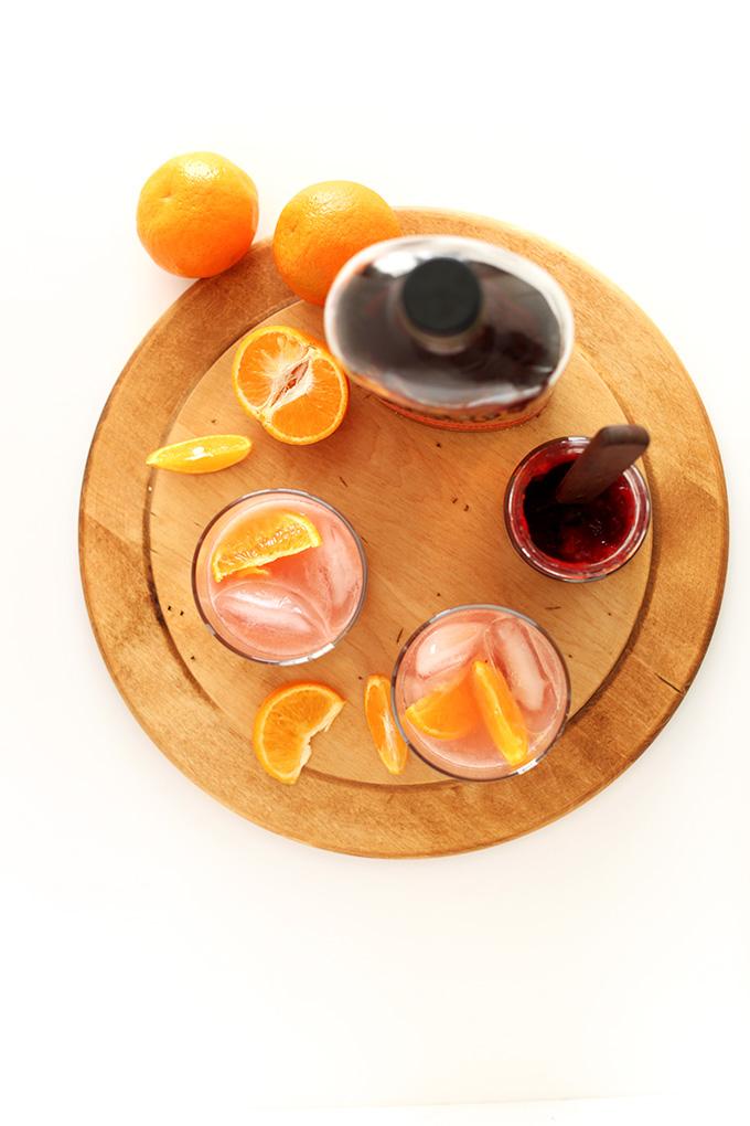 Glasses of our Simple Winter Raspberry Bourbon Smash recipe