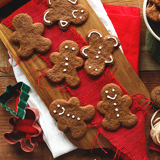 Vegan Gluten-Free Gingerbread Cookies on a cutting board topped with red fabric