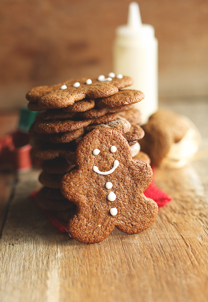 Gingerbread Man leaning on a stack of his fellow gluten-free vegan cookies