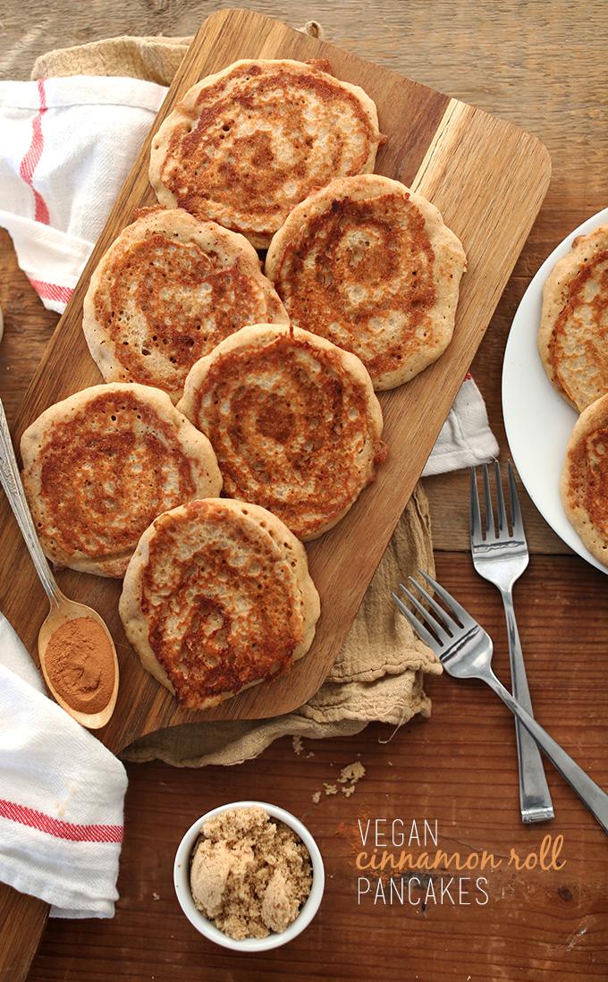 Batch of delicious Vegan Cinnamon Roll Pancakes on a cutting board