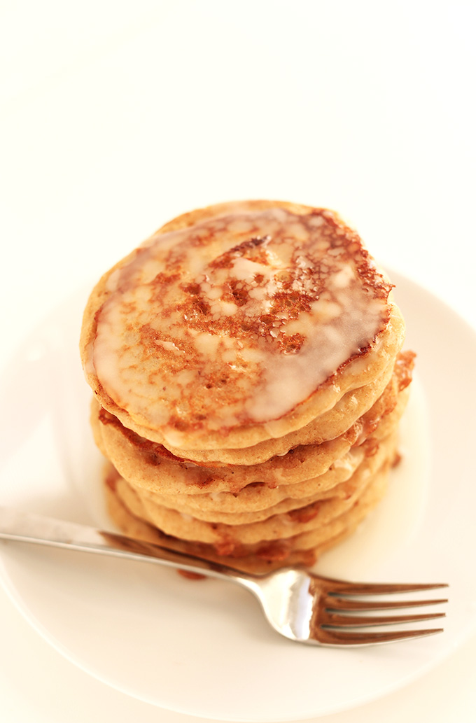 Stack of Vegan Cinnamon Roll Pancakes with icing