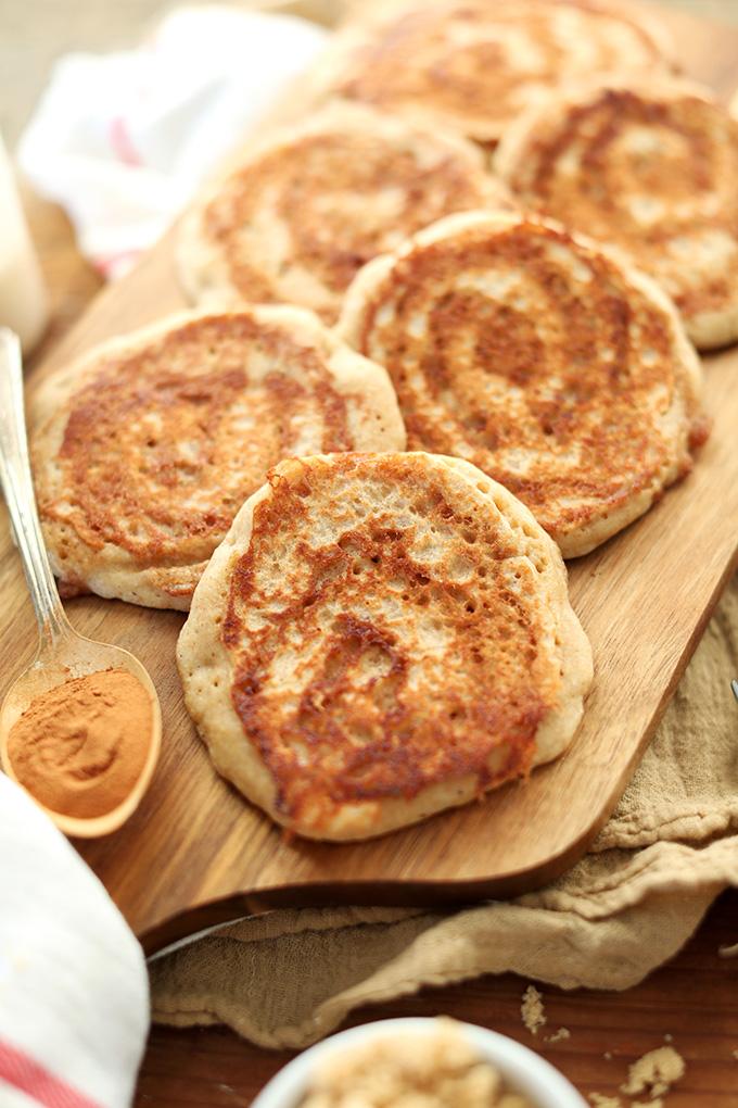 Batch of our Vegan Cinnamon Roll Pancakes recipe on a cutting board