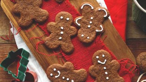 Vegan Gluten-Free Holiday Gingerbread Cookies alongside cookie cutters and a rolling pin