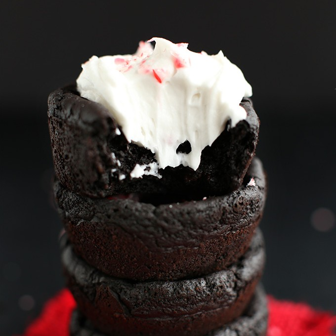 Stack of Vegan Peppermint Brownies with the top one frosted with coconut whipped cream