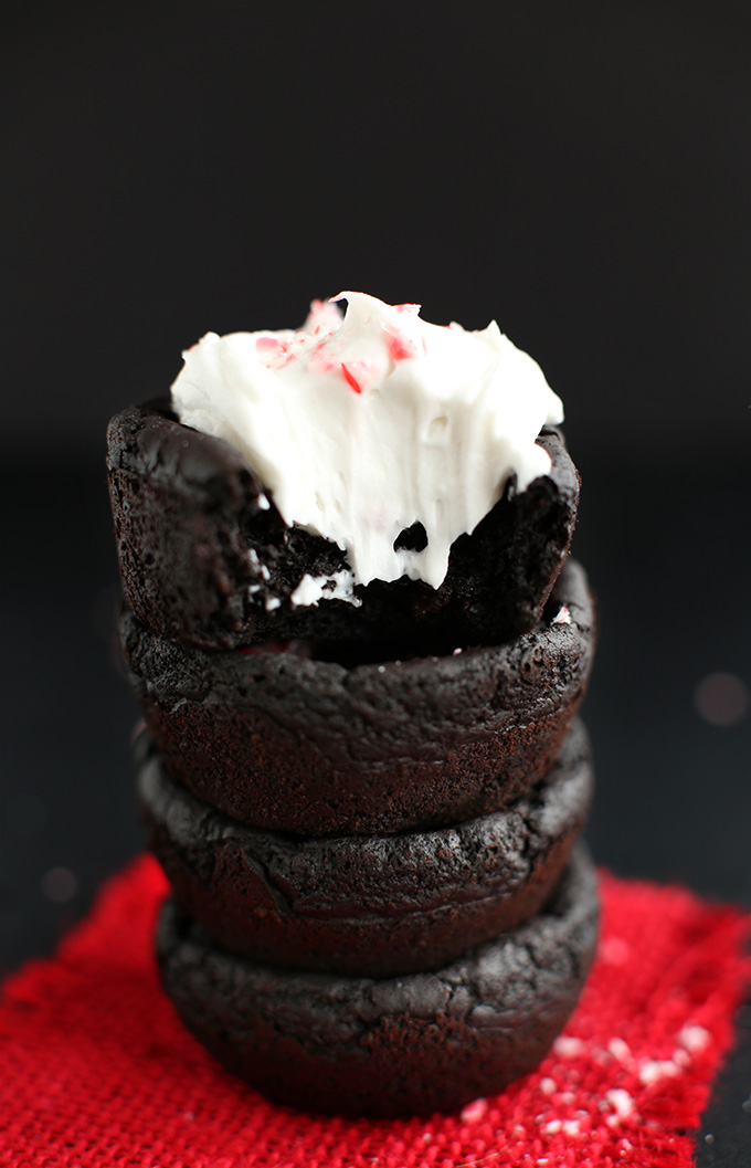 Stack of Vegan Peppermint Brownies topped with coconut whipped cream and crushed candy cane