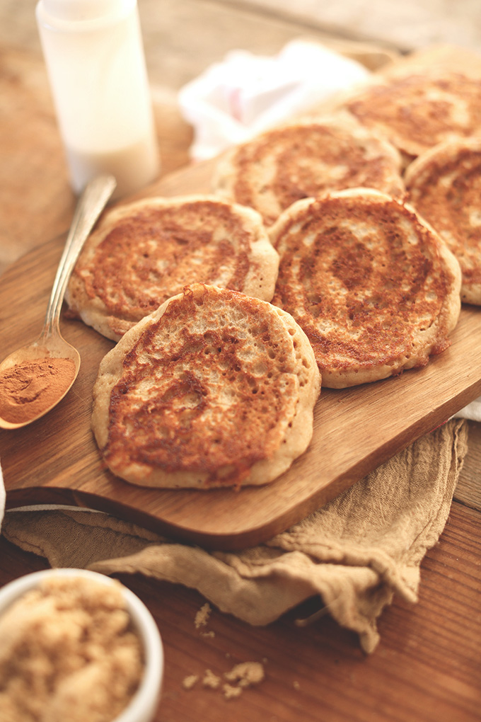 Cutting board with a freshly cooked batch of Vegan Yeasted Cinnamon Roll Pancakes