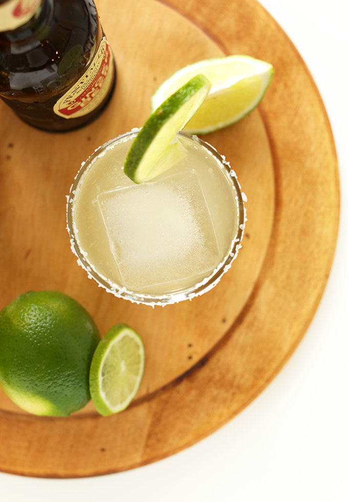 Top down shot of a homemade Ginger Beer Margarita with a salt and lime rim