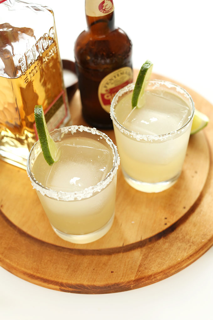 Glasses of Ginger Beer Margaritas with lime and salt rims