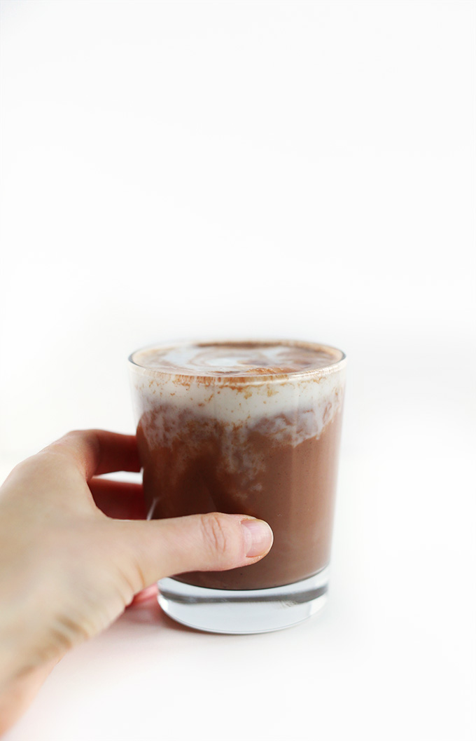 Grabbing a glass of Vegan Hot Cocoa for a warming winter beverage