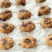 Parchment-lined baking sheet filled with freshly baked Healthy Vegan Cookies