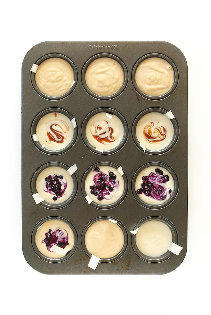 Assorted flavors of Mini Vegan Cheesecake Bites setting up in a muffin tin
