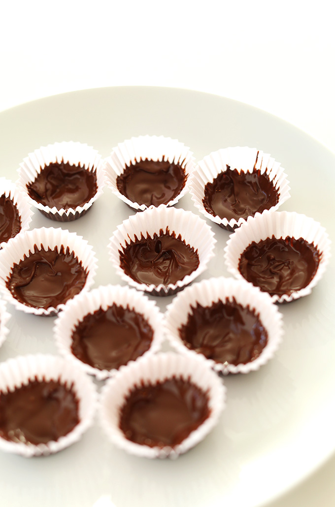 Plate of delicious homemade Chocolate Almond Butter Cups in mini muffin tin liners