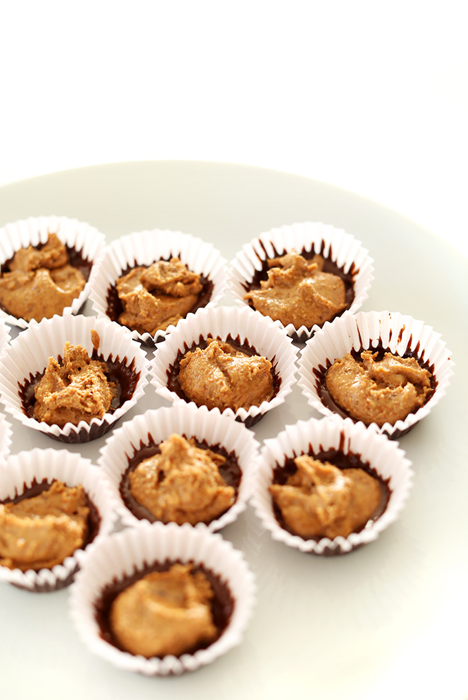 Showing the first chocolate layer and almond butter layer of homemade Almond Butter Cups