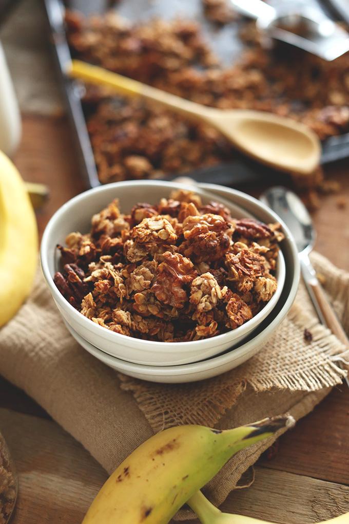 Bowl and baking sheet filled with gluten-free vegan Banana Bread Granola
