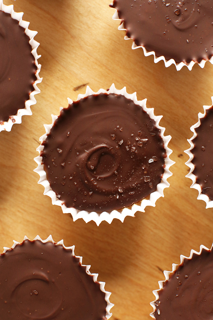 Top down shot of Bourbon Caramel Almond Butter Cups sprinkled with sea salt