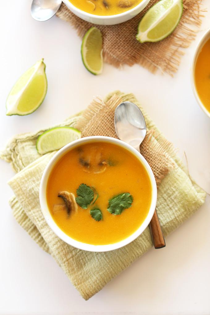 Bowl of Butternut Squash Tom Kha Gai soup topped with fresh basil