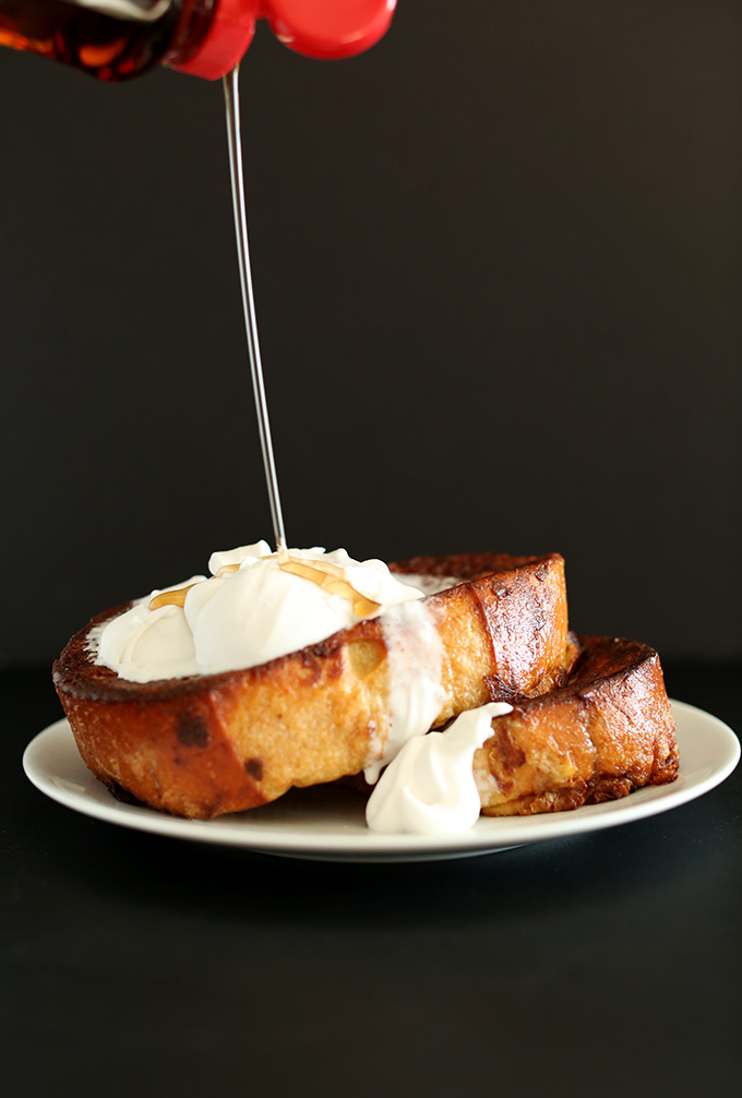 Drizzling syrup onto slices of Coconut Cream Pie French Toast for a dairy-free breakfast