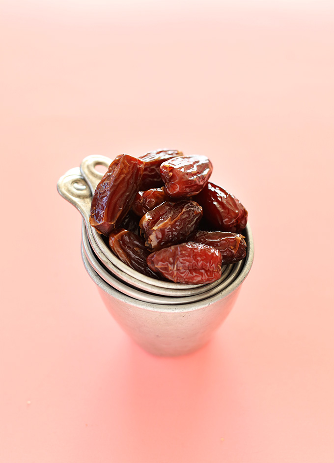 Stacked measuring cups filled with fresh dates