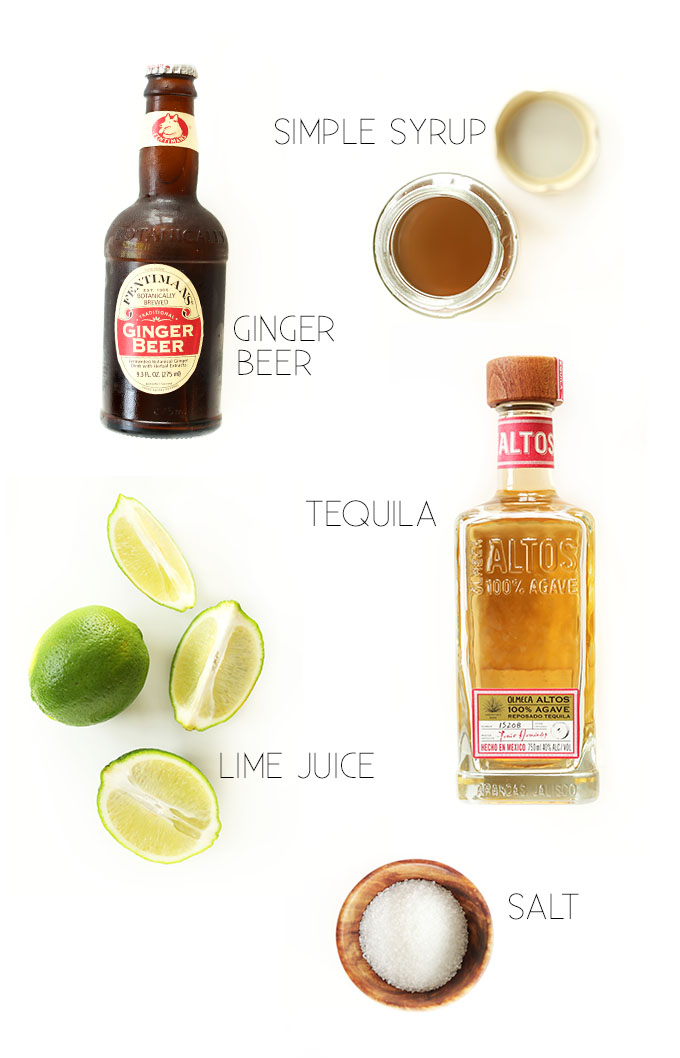 Simple syrup, ginger beer, tequila, limes, and salt for making homemade Ginger Beer Margaritas