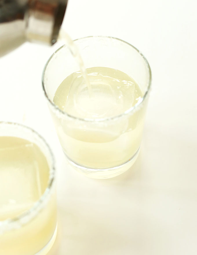 Pouring our Ginger Beer Margarita recipe into a glass