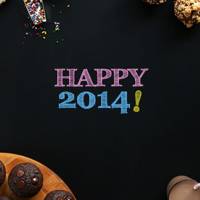 Happy 2014 written on a dark background with some of our sweet treats