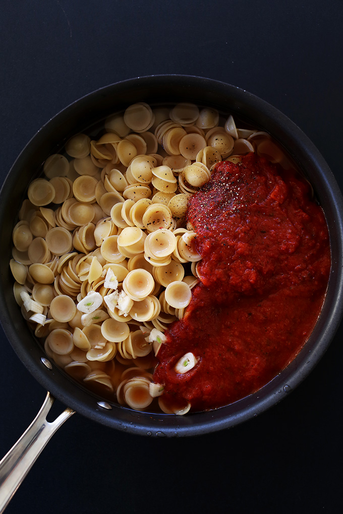 Skillet of orecchiette and tomato sauce for making a simple vegan pasta dish