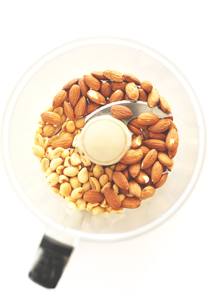 Food processor containing peanuts and almonds for making Peanut Butter Pretzel Truffles