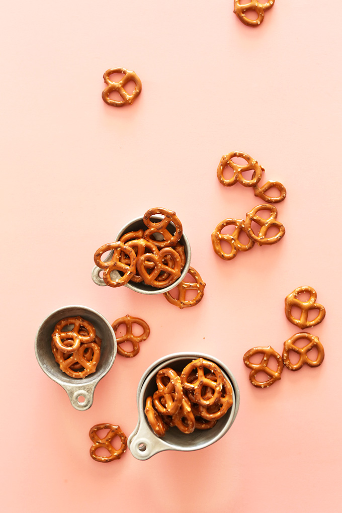 Pretzels in measuring cups and scattered about