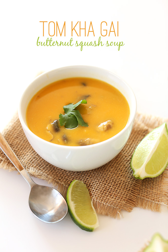 Bowl of Tom Kha Gai Butternut Squash Soup with fresh cilantro and lime wedges