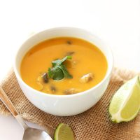 Bowl of Butternut Squash Tom Kha Gai Soup topped with cilantro