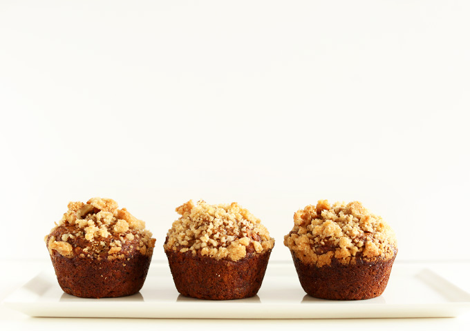 Three Vegan Banana Crumble Muffins on a white plate