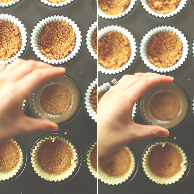 Using a glass to press down graham cracker crust in muffin tins