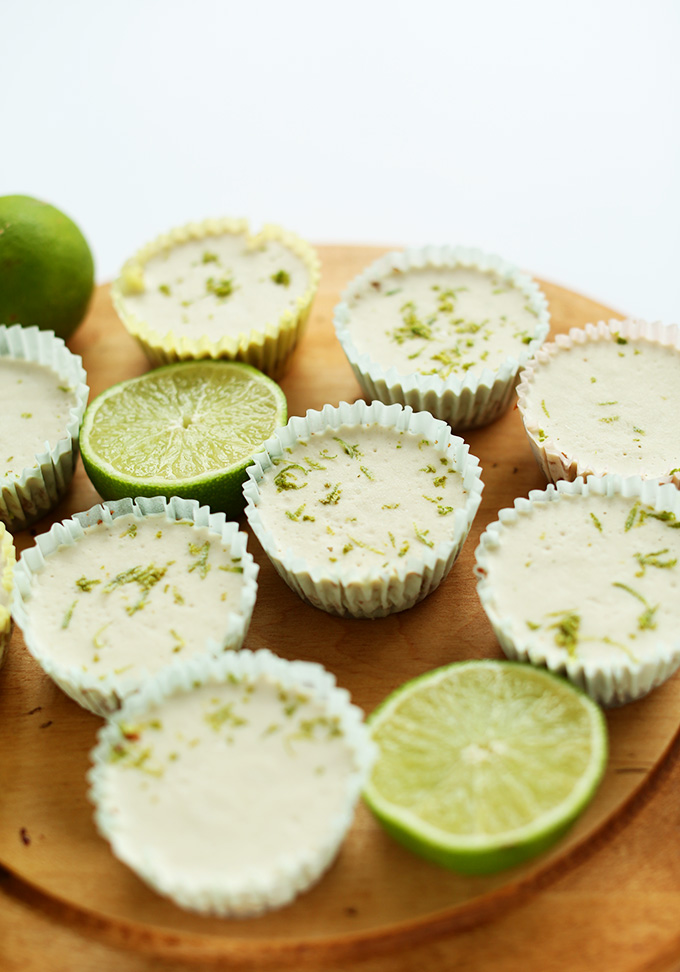 Chilled Mini Vegan Key Lime Pies resting on a baking sheet