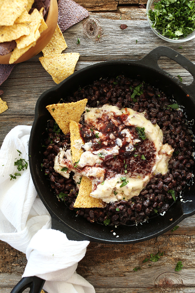 Skillet of Raspberry Chipotle Black Bean Dip and tortilla chips