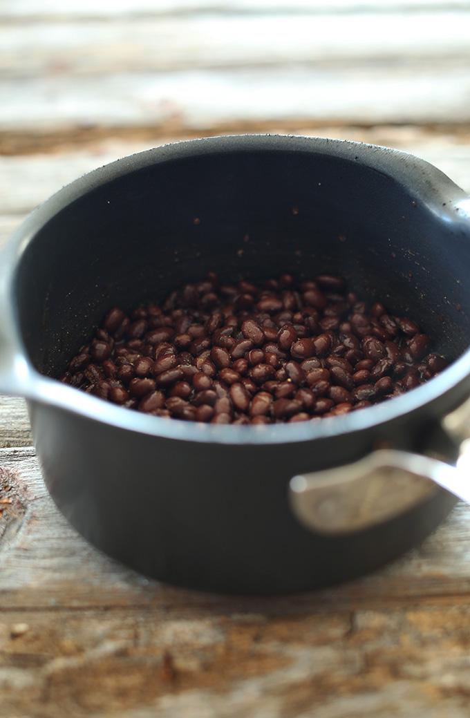 Saucepan of black beans for making homemade vegan chipotle bean dip