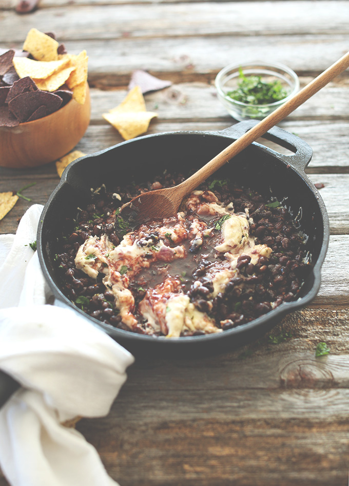 Skillet of Vegan Raspberry Chipotle Black Bean Dip alongside tortilla chips
