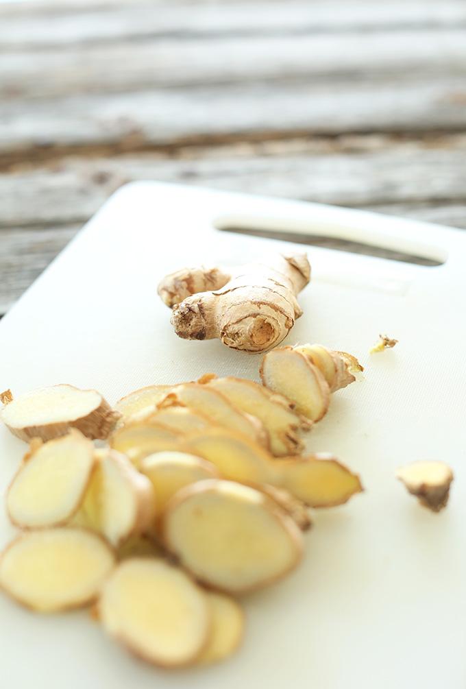 Sliced fresh ginger for vegan Ginger Lattes